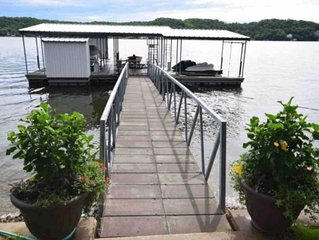 Beautiful Lake front home on level lot with LARGE DOCK!