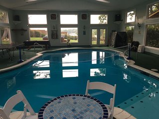 Spacious Waterfront Retreat 8 BR,heated indoor pool,firepit,sand volleyball ct
