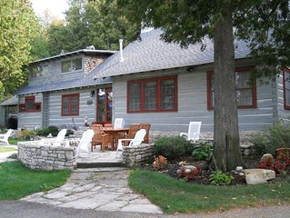 Classic 1927 Shore Log Home. Sleeps 8. Enjoy water views from 7 of 9 rooms!