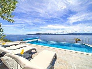 Villa 70 Meter vom Meer entfernt, mit Infinity-Pool und herrlicher Aussicht