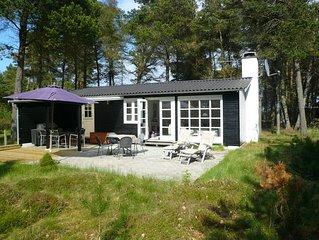 Zwei Minuten zum Strand: Klassisches Sommerhaus auf Naturgrundstück