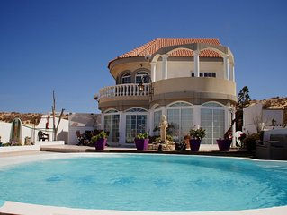 Villa with private pool, spacious terraces and 3 apartments, Privacy guaranteed.