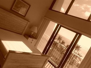 A little piece of paradise. 2 BR/3 BA condo. Steps from your own private beach!!