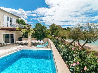 Large family villa with heated pool directly on beach - Sea view from your bed!!