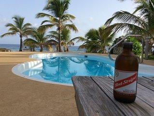 BEAUTIFUL!, palm trees, sand beach, pool w/shade sails, beach cabana, & MORE!