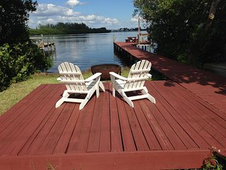 Bayfront home with private dock - beach 2 minutes out the back door