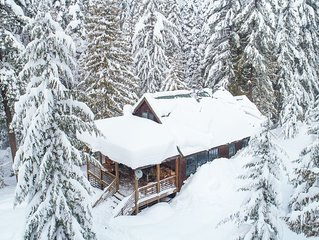 Cross-country ski in - ski out to a modern cabin in winter