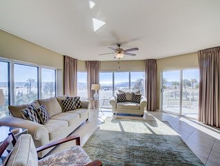Lower level, captivating views! Two swimming pools, hot tub, fitness center.