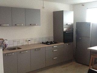 Appartement F2 dans maison individuelle.