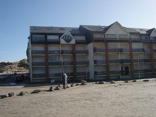 Tres bel appartement  situe au 1er etage face a la mer