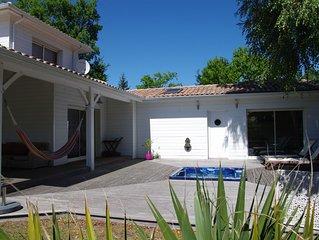 Villa à 200 m de la plage lac Sanguinet avec piscine chauffée, jacouzzi et sauna