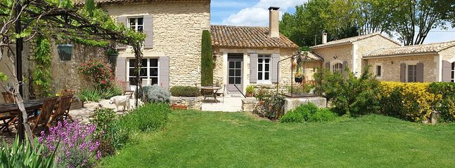 Mas Lou Patio with the gîte part on the right