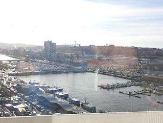 Appartement traversant face port . Vue magnifique