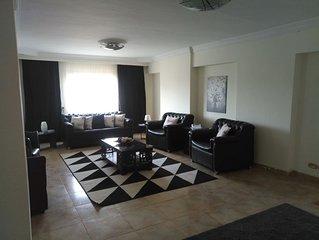 Deux chambres à PALM CITY  dans un spacieux et lumineux  appartement