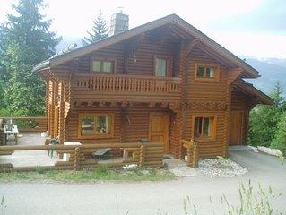Chalet en rondins de bois, station de LA TANIA, domaine skiable de Courchevel