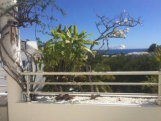 Location T4 vue mer et montagne avec parking, à proximité de la plage de Boucan