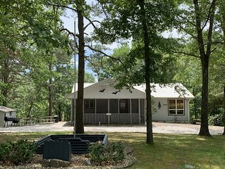 Enjoy peaceful seclusion, the best of Beaver Lake, and access to all of NW AR.