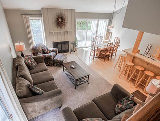 Harbor Springs condo with access to a private beach on Little Traverse Bay.