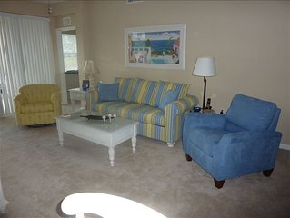 Brightly Furnished 2BR 2BA + Den End Unit Carriage House on Water