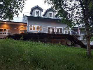 Centrally located lakefront home w/large deck and private dock