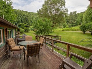Historic, private log cabin w/ deck, fireplace & wood stove - one dog OK!