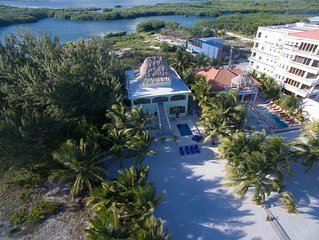 Luxury beach home with plunge pool, pier, rooftop deck and bbq! 4 mi to town