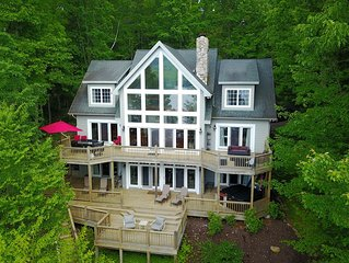 Lakefront home with 5 masters & private dock!