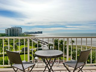 Sunny Marco Island Beachfront Condo overlooking Pool, Palms and Palapas