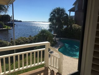beautiful waterfront home with pool and view