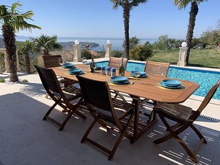 A peaceful and relaxing vacation in a villa with a private pool and a sea view