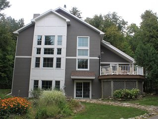 Enjoy Beautiful Sunsets On The Bay In This Large Lakefront Family Retreat