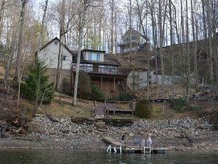 3 BR w/ Loft Gated Waterfront home. Lake/mountain views! Private dock. Sleeps 8