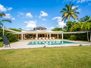 Tropical Modern Villa with 5-Star Staff & 2 Carts, Walking Distance to the Beach
