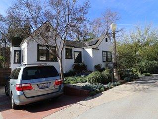 Sunlit home in quiet neighborhood with backyard garden, patio, and playspace