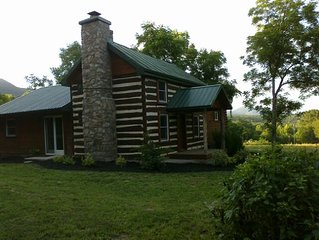 Beautifully appointed log cabin features mountain views, river, trails