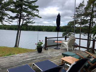 St. Lawrence River Cottage with 107 ft of river frontage and a boathouse