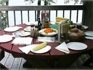 Summertime dining on the deck overlooking the water.