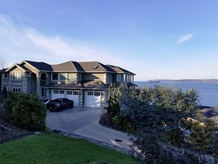 Luxury waterfront private room with patio overlooking the Puget Sound