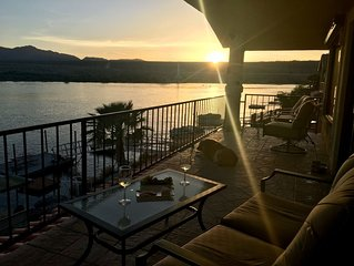 Riverfront with lawn, jet ski dock, and boat dock.  Views and Sunsets!