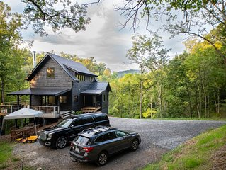 New construction located on 15 acres with private frontage on the Big Ivy River