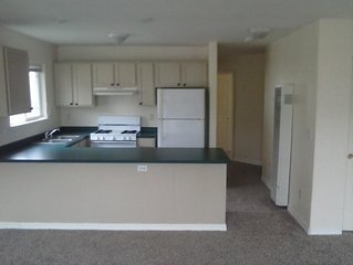 2 full baths, dining room, living room, full kitchen with breakfast bar.