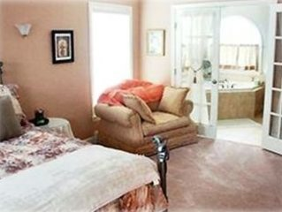 Spacious master bedroom with luxury bathroom, TV, DVD, VCR and stereo