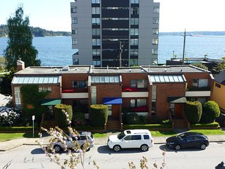 Central safe Location - Water views - walk to restaurants, seawall, beach