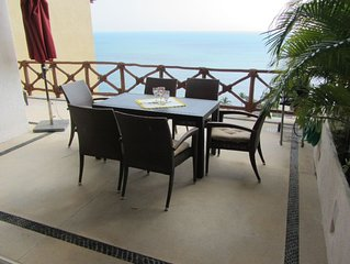 3BR 3 Bath Penthouse corner unit on the beach , 8 community pools,  with views o