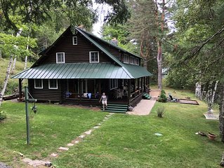 Justawhim-Private Lakefront Log Lodge with Old World Charm steps from the water.