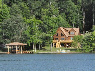 Captivating 5 Bed/5 Bath Lake Front Log Cabin W/ Private Cove & Sandy Beach.