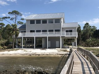Amazing location, Pet Friendly, Bayfront Home with Dock near Bob Sikes Cut!