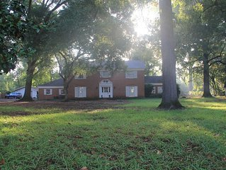 Historic home on 2+ wooded acres w/ pool in heart of Nacogdoches