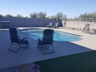 New Resort Style Home, Open floor plan in Buckeye with HEATED  Pool and Hot tub