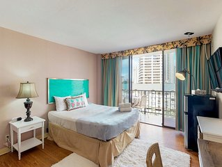 Downtown studio w/a furnished balcony, city views, shared pool - walk everywhere